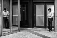 'Alter Ego' (Canadapt) Tags: man building door window reflection mirror shadow street architecture smartphone toronto canadapt smoking smokebreak