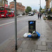 Before you reach the shopfront you 'read' the rubbish