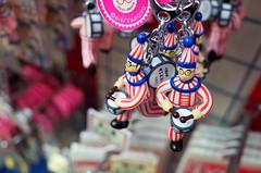 Taro, just hanging around (Eric Flexyourhead (Onoharahigashi)) Tags: city pink blue red urban white detail mobile japan toys bokeh  keitai osaka colourful kansai charms ricohgr chuo dotonbori fragment chuoku     kuidaoretaro