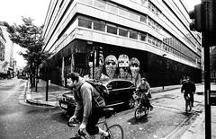 London Street: Cyclists (christait) Tags: street uk streetart london cyclists traffic britain beatles 2012 ilforddelta3200 leicam3 ilfotechc voigtlander21mmf4colorskopar hiptsters