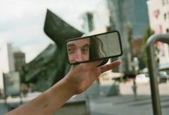 james in a rear-view mirror (swetasart) Tags: city slr analog nuremberg olympus stadt freunde