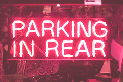 December 5th (Illuminated Bones) Tags: pink decorations hot flower sign glitter neon market parking rear sparkes