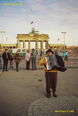 45657-32-ew (anjin-san) Tags: travel musician music streetart cold berlin history film 35mm germany concrete graffiti freedom pentax expression brandenburggate accordion flags rednose 35mmfilm berlinwall streetperformer eccentric 1989 busker brandenburgertor performer pentaxmesuper polizei thewall birdofprey streetperformance eastgermany peoplepower westgermany streetmusician mesuper individualism reinforcedconcrete pianoaccordion silveroxide fallofthewall witnessinghistory artoftheberlinwall