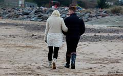 Wooly winter coat (mootzie) Tags: beach socks walking sand couple rocks coat footprints rubber company aberdeen wooly wellies