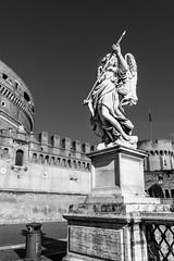 Statue on the Ponte Sant Angelo (bladerunner1511) Tags: bridge blackandwhite italy holiday rome roma monochrome italia angels pontesantangelo