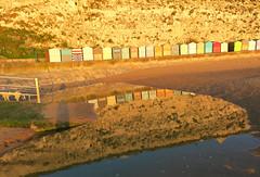 Beach Huts (ray 96 blade (retired)) Tags: shadow sunlight pool reflections prom curve litup broadstairs earlymorninglight stonebay beachhutsilluminated artybeachhuts