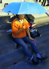 The Blue Umbrella (sinbadcc1) Tags: street woman umbrella cigarette queens streetphoto blueumbrella