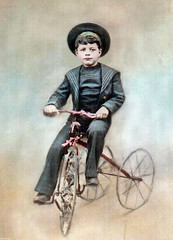 Colorized photo of boy on tricycle (sundogrr) Tags: boy tricycle young cap colorized sailor
