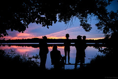 Secluded sunset (michaelraleigh) Tags: trees sunset dog sun lake reflection water silhouette canon landscape outdoors blurred serene smallgroup secluded highquality albertlea 2035mm f28l myrebigisland