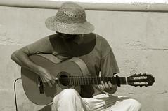 Sitges.Catalonia.Spain (Natali Antonovich) Tags: portrait musician monochrome hat seaside spain guitar hats lifestyle catalonia tradition seashore sitges guitarist seasideresort seaboard hatisalwaysfashionable