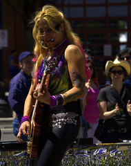 Musician (swong95765) Tags: musician rock tattoo beads guitar vibrant vivid player parade lgbt singer float flamboyant apparel exuberant