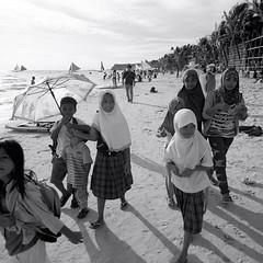 Philippines  Wilfredo Raguro (wilfredoraguro.com) Tags: philippines filipino mamiya6 120film 6x6 medium format mamiya 120 film blackandwhite children muslim hijab whitebeach boracayisland kids schoolchildren umbrella sand coconuts