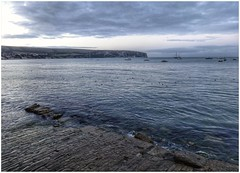 Swanage Bay at dusk. (tetleyboy) Tags: facebook sea dusk harbour coast jurassic worldheritagesite sky clouds frame boats cobble cliff landscape blue