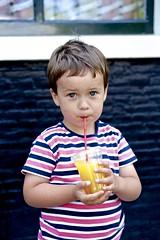 little drinker (MarkVisser1990) Tags: little boy drinks stripes big eyes fuji 35mm f2 orange color