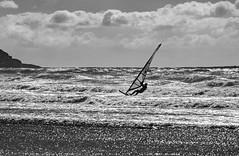 Windsurfer - HMBT! (Jo Evans1 - still trying to catch up!) Tags: mono bokeh thursday foreground windsurfer rough sea black white llangennith gower