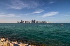 Doha Skyline (Ziad Hunesh) Tags: blue sea skyline clouds canon rocks towers tokina doha qatar 650d 1116mm zhunesh