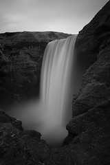 Skgafoss (Subversive Photography) Tags: longexposure travel blackandwhite bw nature landscape waterfall iceland rocks monochromatic spray nd skgafoss tiffen luminositymask danielbarter