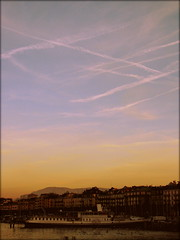 Sunset in Geneva, Switzerland (Wagsy Wheeler) Tags: autumn sunset sky orange sun lake birds river switzerland boat suisse geneva geneve harbour trails leman lakegeneva rhone lacleman suiss aeroplanetrail