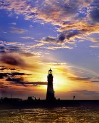 Buffalo Harbor Lighthouse (Vern Krutein) Tags: sunset building architecture clouds coast lighthouses technology shoreline landmark coastal shore maritime coastline nautical beacon navigationaid sunclipse navaid transportationsafety tlhv05p0202