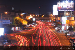 Semburat at Gajah Mada st. and Sultan Agung st. (Haris Riz'Q) Tags: road street city longexposure car bulb night canon indonesia landscape eos town downtown cityscape traffic photograph lighttrail jember 1100d momentwarrior kameradslrgw visitjember