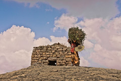 Yemeni life (NeSlaB .) Tags: poverty travel panorama woman mountains nature colors look work canon landscape photo women asia village view traditional country culture photojournalism yemen tradition society developingcountries reportage nationalgeographic haraz neslab