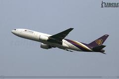 Thai Airways - Boeing 777-2D7 - HS-TJF (raihans photography) Tags: pakistan canon eos thai boeing dslr canondslr lahore efs tha tg thaiairways boeing777 b777 lhe b772 opla boeing777200 canonefs 60d lahoreairport allamaiqbalinternationalairport aiia canonefslens canonefs55250mmf456is canonefs55250f456is canoneos60d boeing7772d7 b7772d7 raihans hstjf raihanshahzad aiiap raihansphotography boeing777family lahorespotters