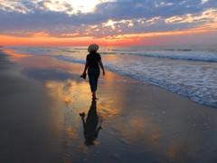Beach walk (Zsaj) Tags: woman beach silhouette sunrise person southcarolina zsaj