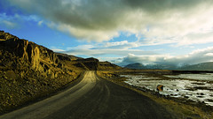 the long and winding road around Iceland (lunaryuna) Tags: voyage road travel clouds landscape coast iceland rocks journey lunaryuna cloudscape settingsun longlight northwesticeland lightmood