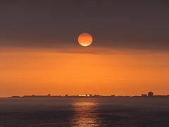 CITY SILHOUETTE (robbiedest) Tags: ocean travel orange sun color love landscape land waterscape