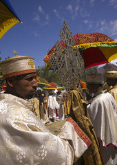 Ethiopian Orthodox Priest Holding A Cross During The Colorful Timkat Epiphany Festival, Lalibela, Ethiopia (Eric Lafforgue) Tags: africa people men art church religious outdoors photography clothing day cross african faith religion ceremony multicoloured icon parade christian celebration holy event parasol devotion crucifix males destination mystical priest christianity ethiopia ornate orthodox groupofpeople cultures pilgrimage coptic developingcountry lalibela humaninterest orthodoxy lifestyles hornofafrica epiphany ethiopian eastafrica placeofworship mysticism brightcolour realpeople artandcraft amhara onlymen colorpicture maturemen africanethnicity artscultureandentertainment africanculture onlymaturemen copticchristianity colourpicture publiccelebratoryevent celebratoryevent ethio1411016