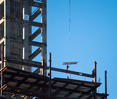 Directing the Beam (Orbmiser) Tags: autumn fall oregon portland construction nikon crane cable beam worker d90 55200vr