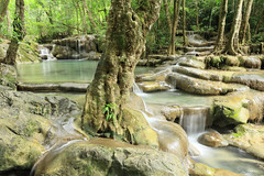 Erawan National Park - Kanchanaburi Province (Geourj. B.) Tags: park blue 2 wild lake fish reflection nature water forest canon river thailand waterfall colorful asia long exposure mark buddha south deep buddhism east clear national level thai 5d asie 16 35 f28 province kanchanaburi erawan