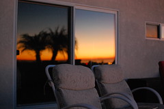 Sit and reflect (oohrahiwo) Tags: ocean california county pink blue trees sunset orange southwest west beautiful yellow cali night palms lowlight nikon quiet view pacific chairs gorgeous peaceful palm deck socal amateur westcoast stucco d40