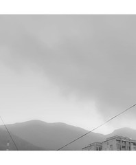 Early In The Morning IV (Melancholy Pool) Tags: sky white mountain black cold lines misty 35mm buildings grey stripes memories foggy freezing wires dreamy connected straight melancholy muted melancholic d5100