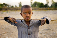 Tigrayan Boy (departing(YYZ)) Tags: africa travel boy portrait people male face zeiss rural kid child play sony poor young dirty 55mm stick sheppard fe ethiopia alpha a7 upperbody tigray staringatthecamera departingyyz sonnartfe55mmf18zalens