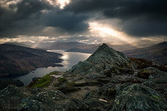 Ben A'an and Loch Katrine (GenerationX) Tags: sunset sky mountains water clouds landscape evening scotland rocks unitedkingdom dusk scottish peak neil gb summit rays trossachs barr lochkatrine benaan stronachlachar locharklet canon6d