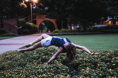 Reaching for Ground (Nate Conn) Tags: flowers blue light portrait woman brown flower green girl beautiful grass yellow photoshop pose garden hair outside outdoors person golden flying model arms legs outdoor magic small dream floating levitation down blouse curly hour hanging dreamy shorts impossible laying