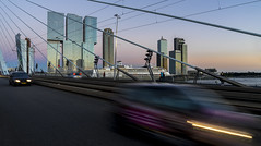 traffic on Erasmus Bridge (Blende1.8) Tags: skyline urban verkehr traffic brcke bridge erasmusbrcke erasmusbrug erasmusbridge rotterdam netherlands niederlande architecture architektur city cityscape street strase auto car schiff ship skyscraper hochhaus hochhuser modern contemporary sony ilce7m2 a7ii a7m2 24240mm colors colours colourful vivid fluss river nieuwemaas maas