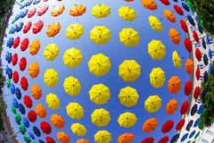 Mary Poppins Garage (CoolMcFlash) Tags: vienna art dornerplatz colors colorful umbrella fisheye canon eos 60d sigma 10mm wideangle sky lowangle many viele wien kunst kunstprojekt farben bunt regenschirm pattern texture muster textur himmel fischauge weitwinkel fotografie photography sommer summer