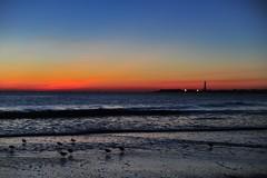 NJ1_5548-small (lauren3838 photography) Tags: ocean sunset sky lighthouse seascape beach nature birds clouds ilovenature newjersey sand nikon surf waves nj capemay atlanticocean d700