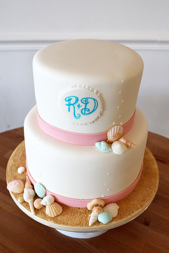 Sea Shells on Beach Wedding Cake with Pink Ribbon Trim