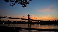 Triborough Twilight (firecomet) Tags: nyc newyorkcity sunset ny newyork skyline evening twilight dusk manhattan queens eastriver astoria suspensionbridge astoriapark triboroughbridge