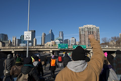 Black Lives Matter march down I-35W (Fibonacci Blue) Tags: brown white black minnesota race march michael photo eric closed martin protest picture minneapolis police demonstration human photograph rights interstate activism mn brutality garner activist i35 trayvon i35w shutitdown ericgarner fibonacciblue blacklivesmatter tcshutitdown