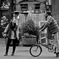 DSCN2777 (Akbar Simonse) Tags: street camera city urban bw woman man holland blancoynegro netherlands monochrome bicycle square photographer cyclist zwartwit candid nederland streetphotography denhaag bn thehague fiets foldingbicycle streetshot dahon fietser vierkant lahaye sgravenhage vouwfiets agga straatfotografie straatfoto akbarsimonse peopen