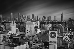 Dark City ([~Bryan~]) Tags: city bw weather japan architecture skyscraper tokyo shinjuku cityscape shibuya metropolis metropolitan darkcity urbanlandscape ndfilter daytimelongexposure