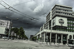 no meio da estrada (L O I C) Tags: road city trees sky house building architecture clouds landscape grey cityscape perspective bicolor arrange