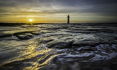 Perch Rock Sunset (grahamhutton) Tags: sunset sun lighthouse ferry liverpool rocks waves glow northwest windmills wirral newbrighton stenaline rivermersey perchrock perchrocklighthouse