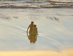 Summer love of gold,  romance and intimacy (Psychic Insights) Tags: blue sunset sea people love water golden sand surf waves outdoor beaches hugs saltwater