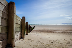 Leading Lines (NVOXVII) Tags: wood blue sky beach silhouette composition landscape coast interesting sand nikon outdoor space footprints bluesky seafront dslr distance groyne chill vast d3200 1855m