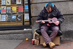 The Ukulele Player (AntyDiluvian) Tags: cambridge man guy boston ukulele massachusetts harvard homeless books bookstore harvardsquare massave massachusettsavenue harvardbookstore